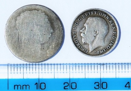 George III sixpenny and George V threepenny bits (obverse).